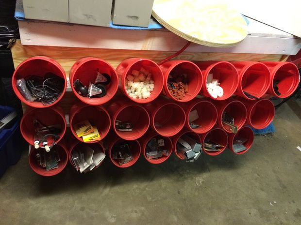 Storage bin rack from recycled plastic coffee containers #organization #storage from Instructables