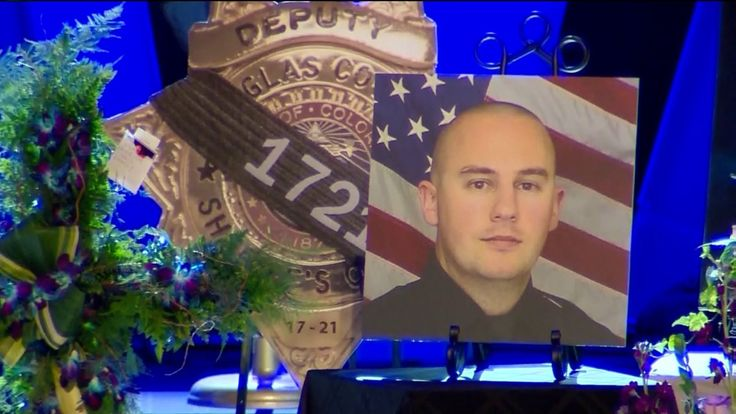 DOUGLAS COUNTY, Colo. -- The end of watch call for Dep. Zachari Parrish, the Douglas County Sheriff's Deputy shot to death while responding to a call last Sunday, was played at Parrish's funeral on Friday. The end of watch call is the last radio call placed to a law enforcement officer who has died in the line of duty.