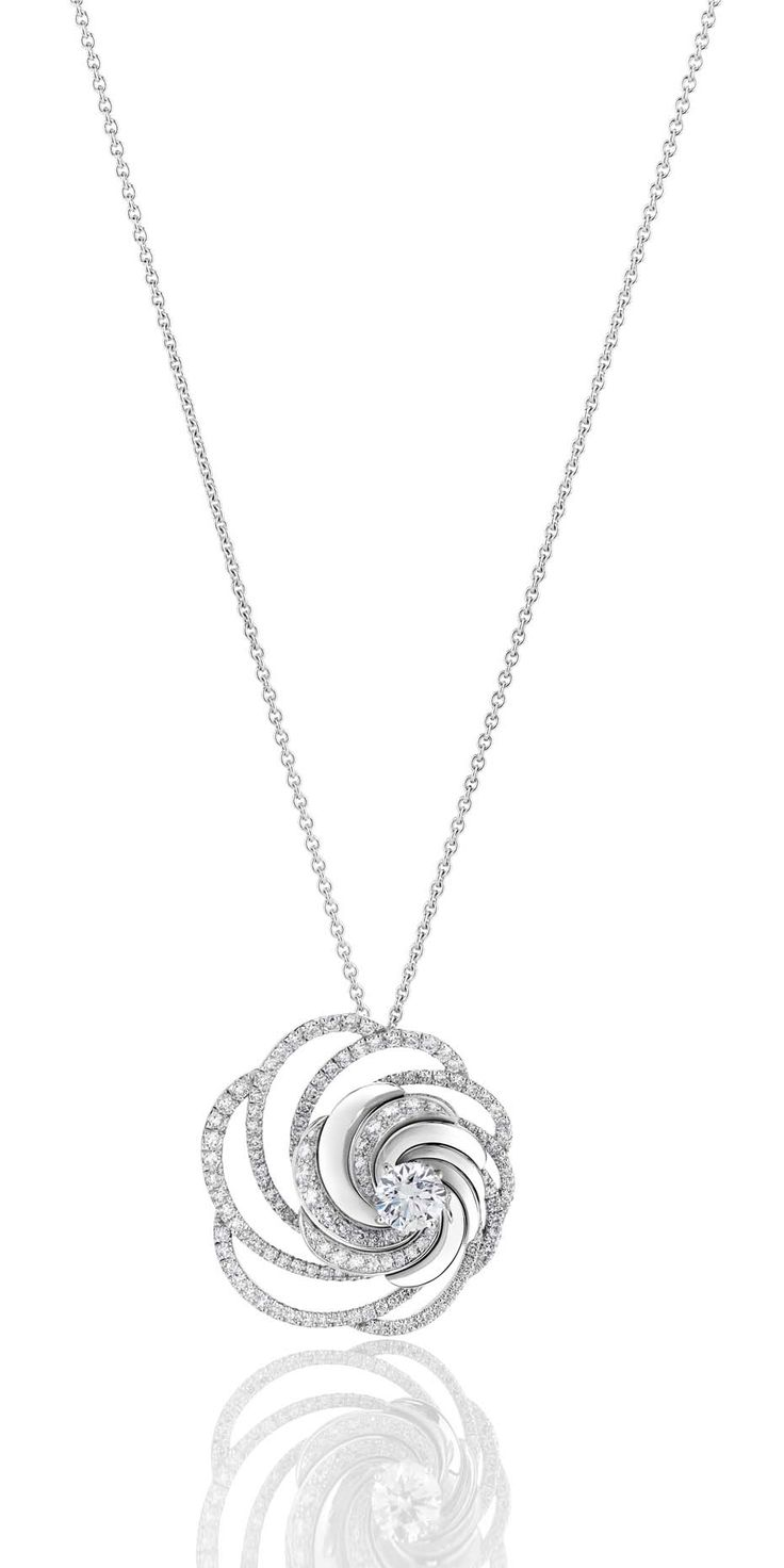 De Beers Aria diamond necklace in white gold embellished with pavé diamonds surrounding a central brilliant-cut diamond.