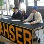 From left: Lahser High School seniors David Attenson (football, Northwood), Elena Miller (cross country, Northwestern) and Andrew Gikas (football, U.S. Air Force Academy) sign their national letters of intent on national signing day Wednesday at Lahser High School.