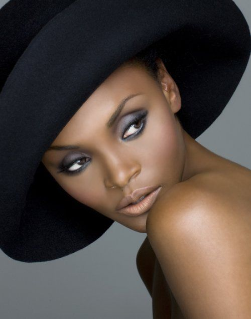Love the hat, but adore her make up. Beautiful!
