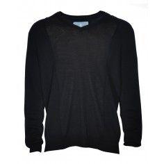 The black thin knit jumper goes over a shirt or underneath a blazer or denim jacket.