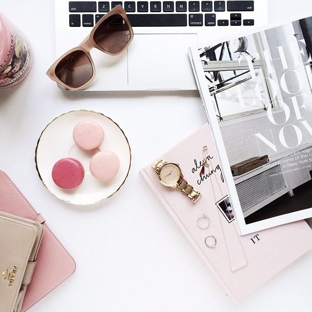 Flat Lay:- desk- magazine- sunnies- macarons.