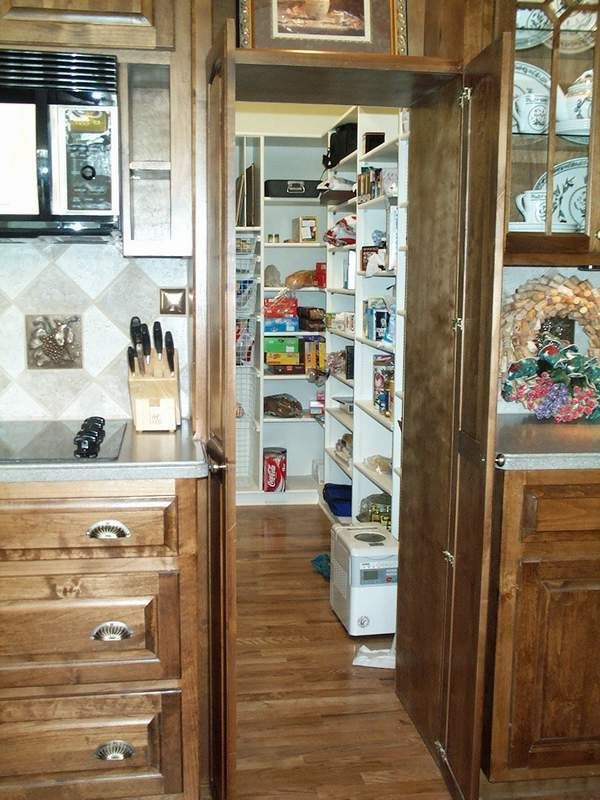 A hidden pantry!  Just think a place to put all those extra dishes that you only use once a year.  No more sitting on the floor to reach way back in the lower cabinet.  A MUST if I ever get to build a new home.