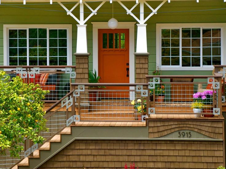 Charming An Updated Porch Leads To A Charming Lime Green House With A Bright Orange Front  Door.