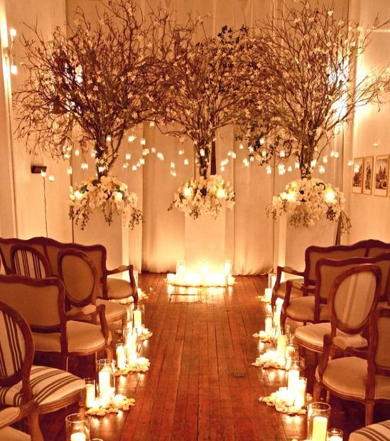 Beautiful!!! Candles for the aisles and hanging mercury glass votive candles for the two large entry arrangements