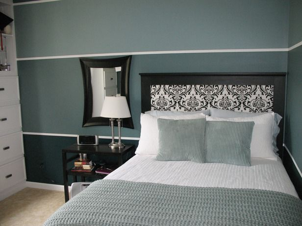 The dainty print on the headboard contrasts nicely with the large-scale stripes on the wall.