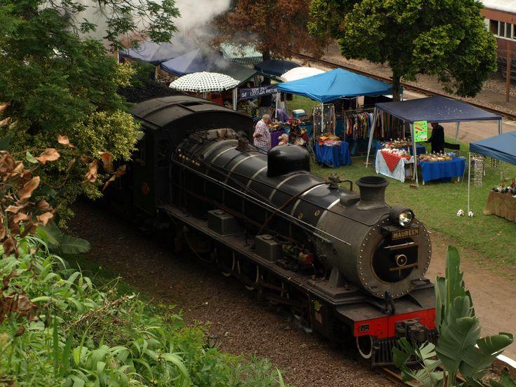 "The Inchanga Choo Choo pulled by the class 3BR locomotive ""Maureen"" arriving at Inchanga Railway Station.  Taken by Bruce D Bennett"