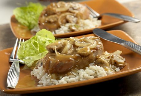 These browned boneless pork chops are served with a savory mushroom and mustard sauce that's as easy to make as it is delicious.