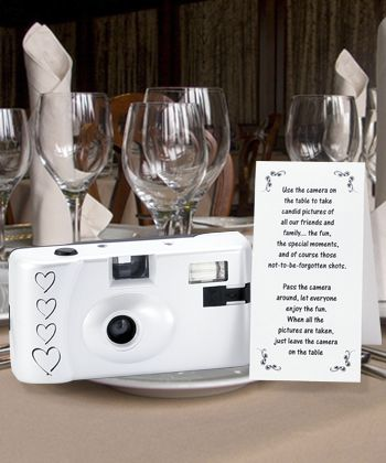 disposable camera for each table at wedding reception for guests to take pictures with for bride and groom.