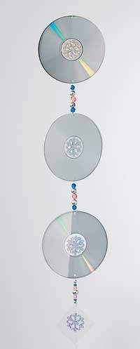 What a great way to reuse those old compact discs! Irene Andreaco of Whitaker, Pennsylvania dreamed up this clever spinner, which throws off brilliant colors as it moves. Make several, in varying sizes, to add a little glitz to a wedding reception, dance or shower. (Use bead colors that complement the decor.) Or just hang one in a sunny window at home to enjoy a private, ever-changing light show.