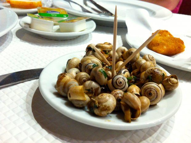 In Portugal, snails are a bar snack, a plate piled with maybe two or three dozen miniature hulls.