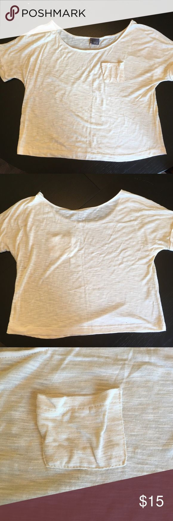 Cream crop top Cream crop top.  Features tiny Breast pocket. Urban outfitters sparkle and fade size xs. No materials tag. Urban Outfitters Tops Crop Tops