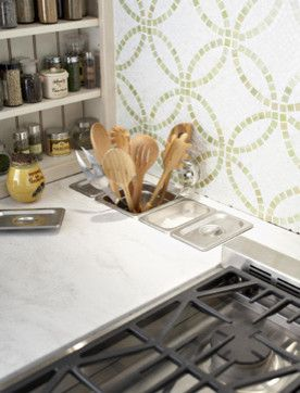 I love the idea of salt & pepper wells near the cook top...I would prefer them behind it.  I like the utensil storage too.