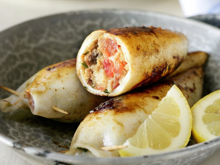 Squid stuffed with feta, parsley and chorizo - Fresh tender squid is beautiful served wrapped around a creamy, salty feta and chorizo filling. Serve with a squeeze of lemon juice for a light Summer meal or a gourmet starter.