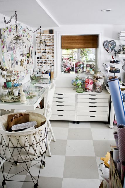 There are actually quite a few elements I love about this room!  The ikea drawers seem like they would work great for punches.  I love the different styles of jars for ribbon.  Like the round rolling cart here in the front.