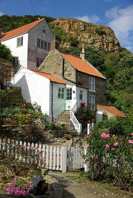 Runswick Bay, Yorkshire: With its sweeping, sheltered bay and charming red roofed cottages, Runswick Bay is one of the Yorkshire Coast's prettiest destinations. The sandy beach, which once provided anchorage for brightly coloured fishing boats, is now a family favourite for rock pooling, fossil hunting and coastal walks, where you can admire the breathtaking sea views.