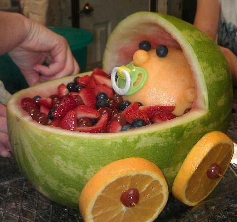 Watermelon baby carriage. Watermelon, strawberries, blueberries. Thick Orange slices, toothpicks, pacifier.