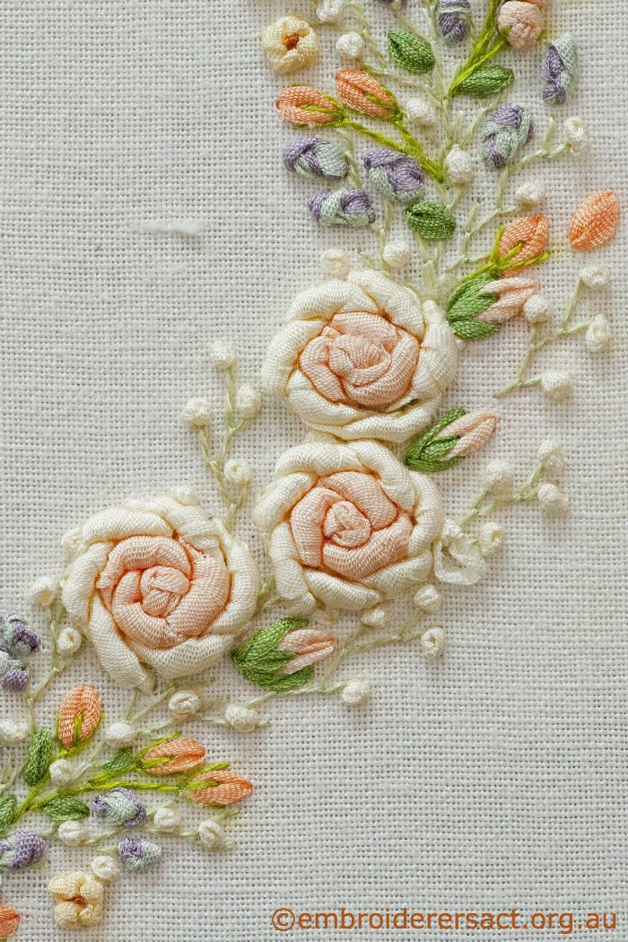 Detail silk ribbon roses on embroidered heart in