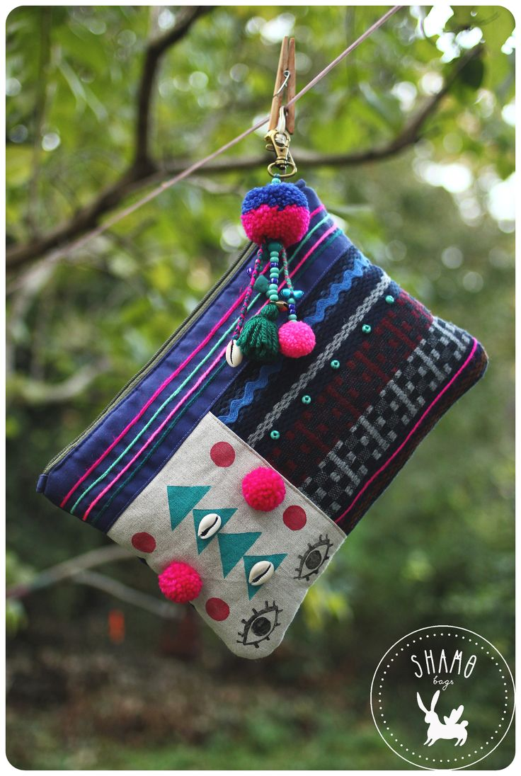 handprinted and hand decorated SHAMO clutch
