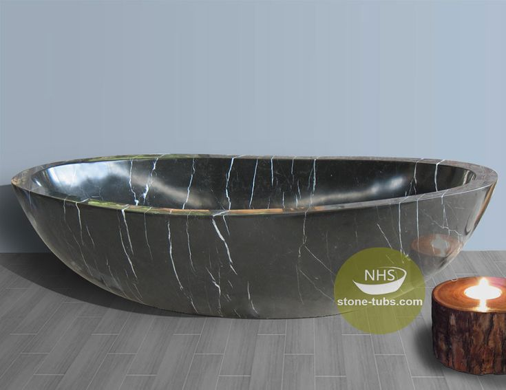 Black marble with white lines soaking tub oval shape, high polished surface, luxury design for your bathroom.