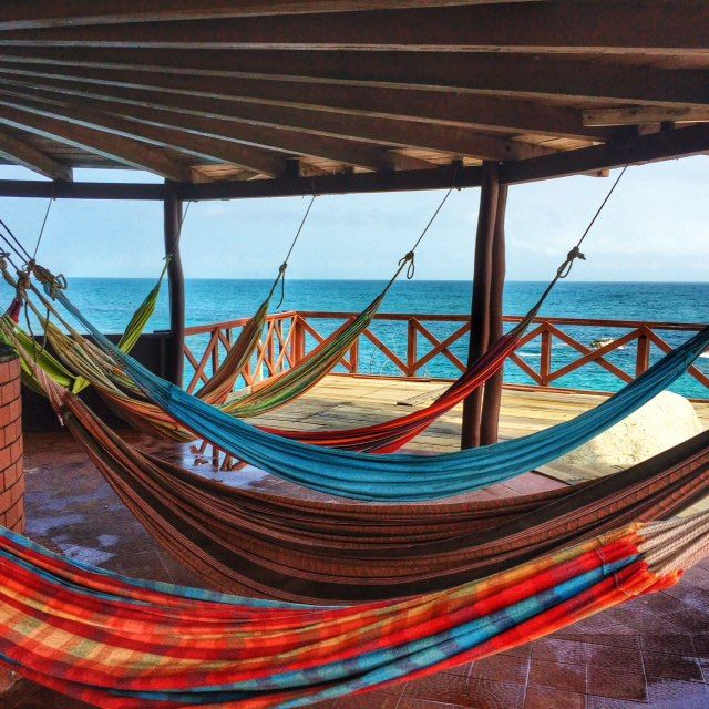 Best places to visit in Colombia - Sleep in a hammock on top of the rock at cabo San Juan