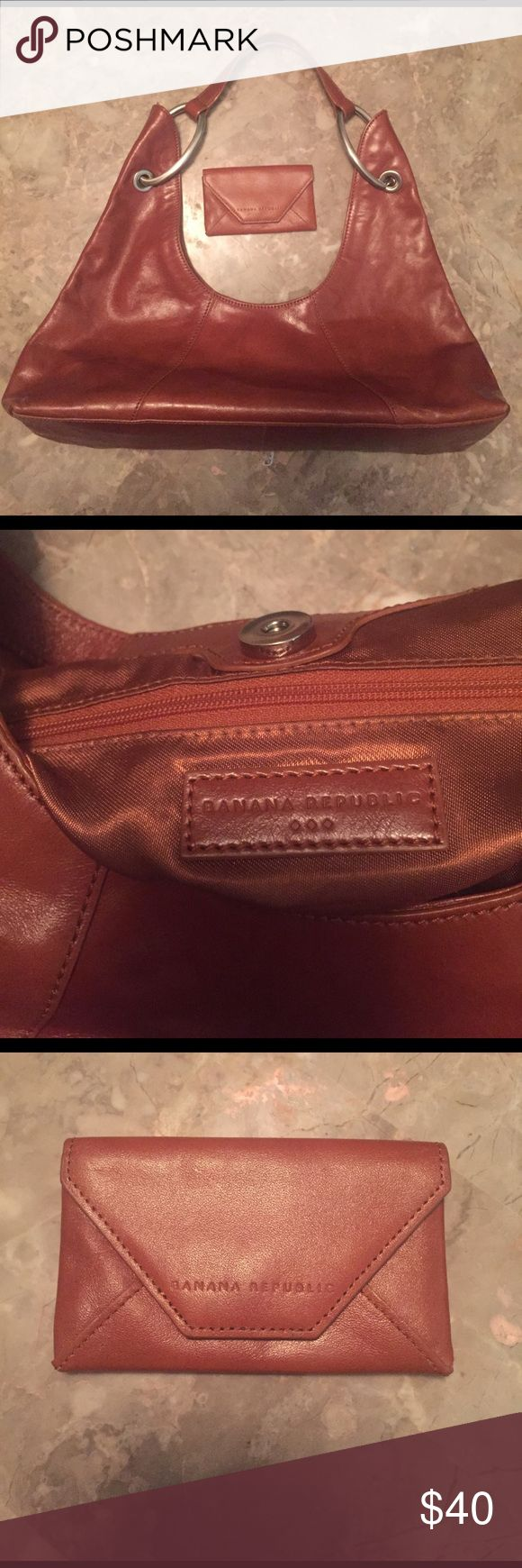 Banana Republic Handbag Banana Republic handbag. Used but in very good condition. Comes with matching cardholder. Small/medium sized Banana Republic Bags Hobos