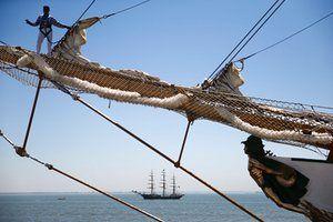 Sailor standing on bowsprit