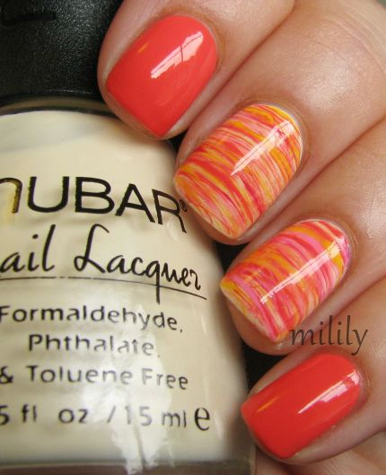 mililypolish:    Orange franken with accent nails (I'm still trying to figure out what to call these).   ~Polishes used for accent nails: Nubar Yellow Primrose (base), Orange franken, Essie Watermelon, Color Club Yum Gum, andColor Club Almost Famous.