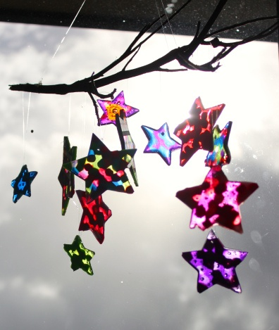 Wind Chime / Sun Catcher: We used a tupperware baking sheet under them, but I think any flexible non stick surface would do, (baking paper).  Simply fill some metal or oven proof cookie cutters with plastic pony beads (thicker at center, 1 layer at edges), and bake at around 180c.  Keep an eye on them until they are all melted.