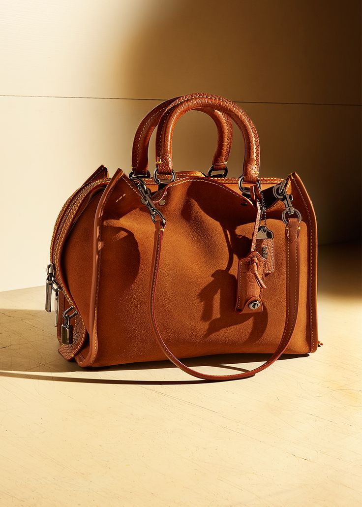 Spring's editor-favorite satchel is spacious and striking. This super-luxe iteration of the Rogue is sumptuous in suede leather and classic in saddle color. Metal feet provide protection so you can place it down with little less worry.