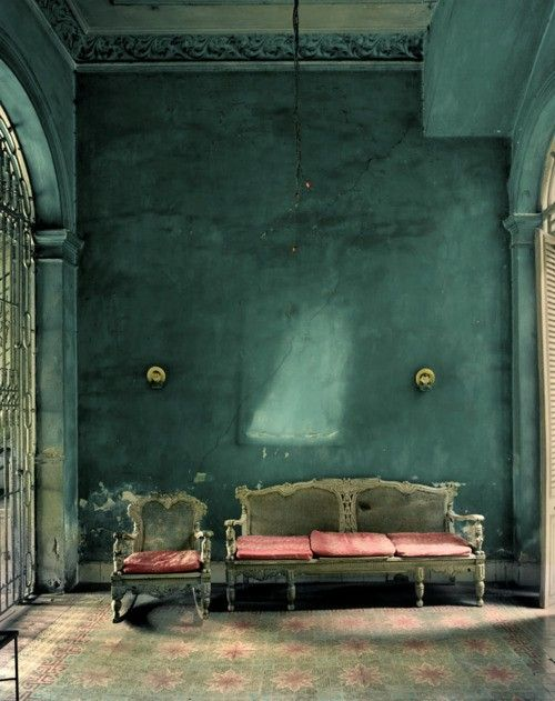 Interiors, turquoise. Note that the floor is either tile or painted, not carpet, and the architectural detail in the ceiling moulding and fantastic windows.