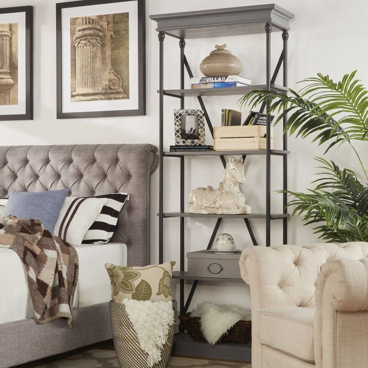 Balance on-trendy, loft-worthy appeal and understated, transitional style in any space with this openwork etagere bookcase, the perfect stage for any display. Featuring four tiers of poplar wood shelving and a powder-coated metal cube frame, this design offers a chic touch to your ensemble. Try adding it next to a button-tufted headboard in the master suite as a bold nightstand alternative. Stock up the lower shelves with vintage-inspired alarm clocks and stacked books from this month's r...