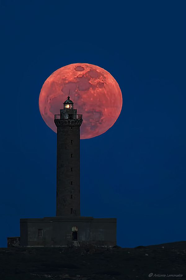 "Beautiful stone lighthouse, Ermoupolis, Syros island, Greece. ""The largest full moon"" by Antonis Lemonakis, via 500px."