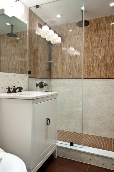 Artistic Tile | This New York City bathroom features two patterns from our Jazz Glass collection; Coltrane Creme in the Miles Modular pattern and Ella Light Brown Satchmo Sticks.