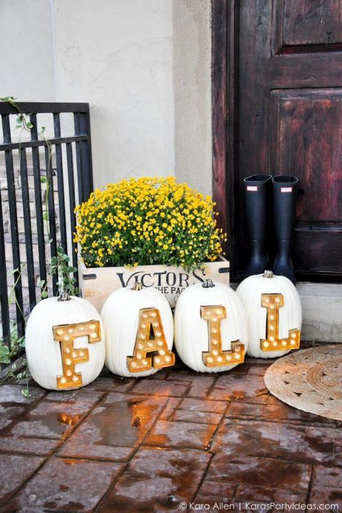 "These cheerful pumpkins were made to be in the spotlight. Spell out ""fall"" using marquee light letters on pumpkins displayed near your front door."