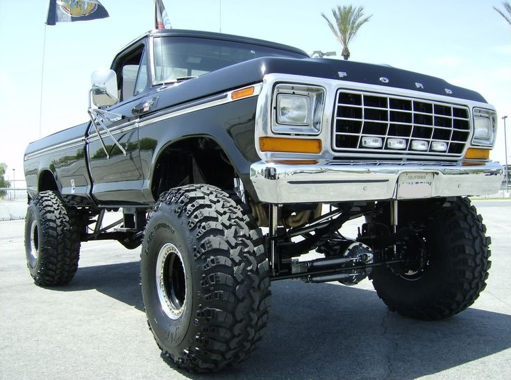 jacked up ford pickup trucks for sale - Google Search - looks just like ours! Only ours has M-A-C-K instead of FORD across the front.
