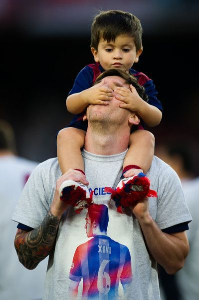 Lionel Messi of FC Barcelona plays with his son Thiago Messi after the La Liga match between FC Barcelona and RC Deportivo La Coruna at Camp Nou on May 23, 2015 in Barcelona, Catalonia.