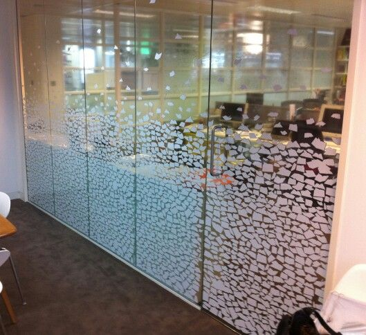 Glass markings manifestation. Each white peice is a book at different angles of openef pages. This was a project we did in london for a publishers