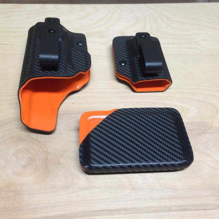 Two tone holster, mag holder, Kydex wallet. Orange and black carbon fiber. www.wolfhollowtactical.com