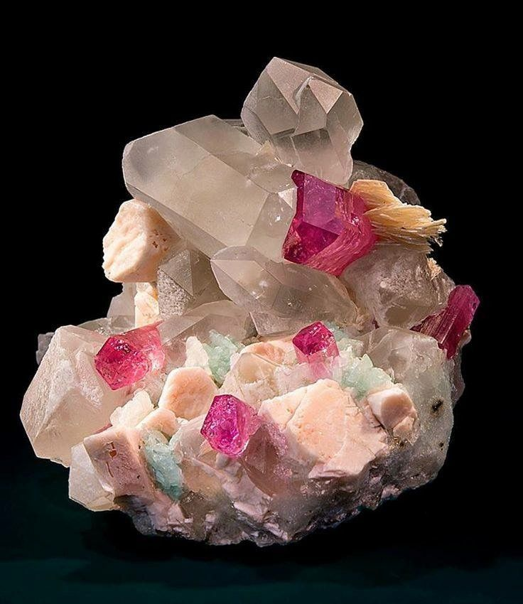 Tourmalines spread about a matrix of quartz, mica, orthoclase and cleavelandite --- Mandalay Division, Myanmar.  Geology Wonders