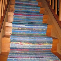 I bought 3 dollar rag rugs and am going to stich/weave them together for a runner up the stairs. We need to go on a car trip so I can do it in the car.