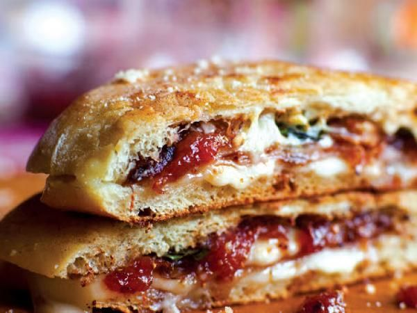 Fig Relish and Ham Sandwiches 2 artisanal roll, or 4 slice ciabatta sweet butter toma cheese, sliced or grated several thin slice prosciutto basil leaves arugula olive oil grated parmesan cheese, for garnish fig relish