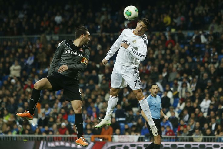 Real Madrid's Cristiano Ronaldol, right, in action with Espanyol's Sergio Garcia, left, during a Copa del Rey soccer match between Real Madrid and Espanyol at the Santiago Bernabeu stadium in Madrid, Spain, Tuesday, Jan. 28, 2014.