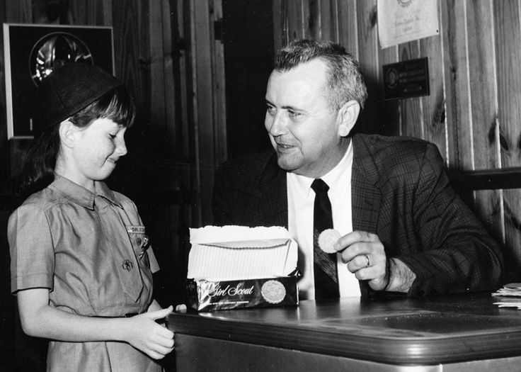 Fort Walton Beach Mayor Ed Brown is shown sampling Girl Scout cookies in this 1960s Daily News photograph.