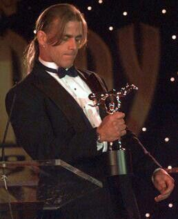Wwf shawn michaels wins a slammy award in the 90s