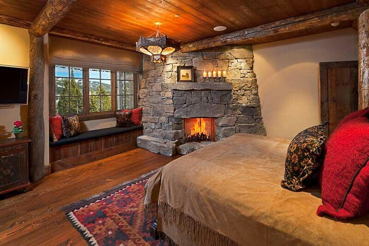 Log cabin bedroom with a stone fireplace yes please for Cabin bedroom designs