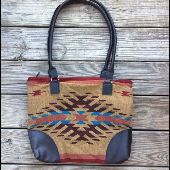 "Faux Vegan Leather ethnic Kilim Aztec tote bag Faux vegan leather trimmed knit fabric Kilim style ethnic print tote bag. 14"" tall, 17"" wide with double 33"" handles. New without tags. Bags Totes"