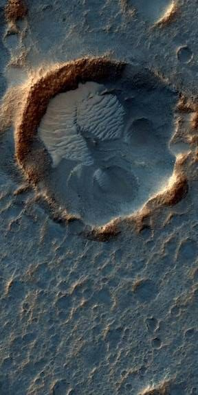 This May 2015 image from the HiRISE camera on NASA's Mars Reconnaissance Orbiter shows a crater with dune formation located in a region on Mars called Acidalia Planitia. Credit: NASA/JPL-Caltech/Univ. of Arizona
