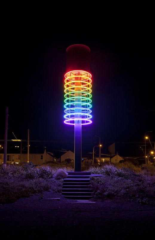 """Andrew Drummond: Tower of Light, Cobham Drive, Wellington -- """"Tower of Light"""" is a machine that uses the wind speed and converts that into light using very simple technology. The rotor at the top of the tower spins in accordance to the wind speed. This rotational speed is read via a controller, which then switches on neon rings in accordance to the speed of the rotor, which is determined by the wind speed."""